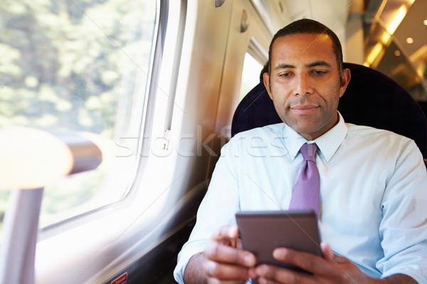 Empresário pendulares trem leitura livro homem Foto stock © monkey_business