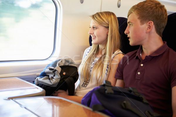 Relaxante trem jornada homem mulheres Foto stock © monkey_business