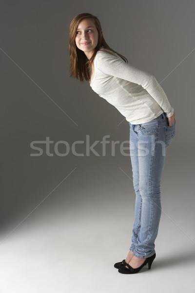 Teenage Girl Standing In Studio Stock photo © monkey_business