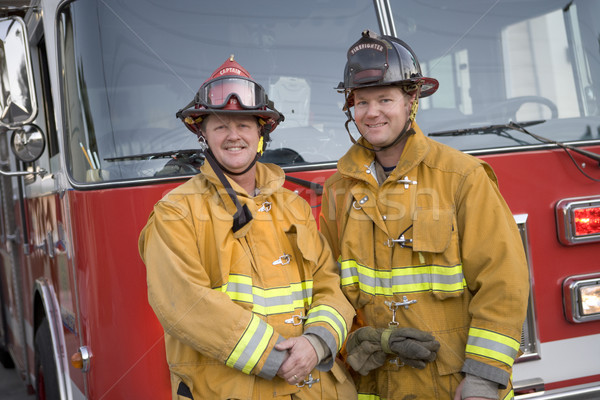 Portrait of two firefighters by a fire engine Stock photo © monkey_business
