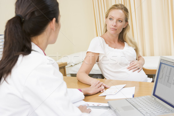 Doctor with laptop and pregnant woman in doctor's office Stock photo © monkey_business