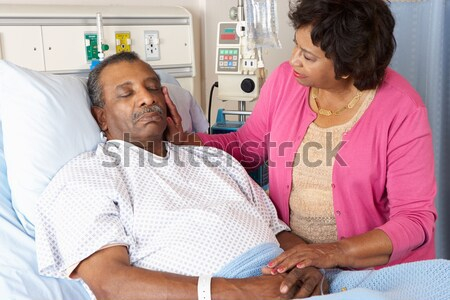 Senior Couple Standing In Hospital Together Stock photo © monkey_business