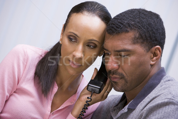 Couple listening to news over phone Stock photo © monkey_business