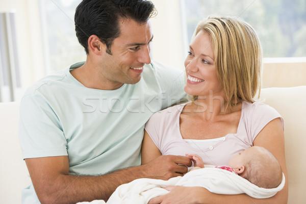 ストックフォト: カップル · リビングルーム · 赤ちゃん · 笑みを浮かべて · 家族 · 母親