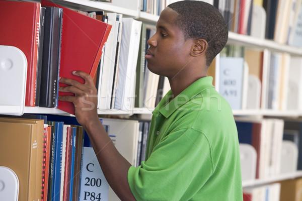 Сток-фото: книга · библиотека · шельфа · мужчины · студент