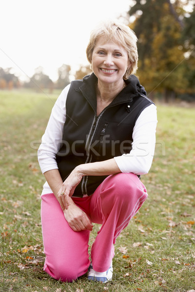 Portrait Of Senior Woman Crouching In The Park Stock photo © monkey_business