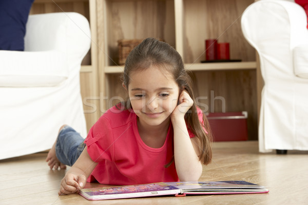 Stock photo: Young Girl Reading Book at Home