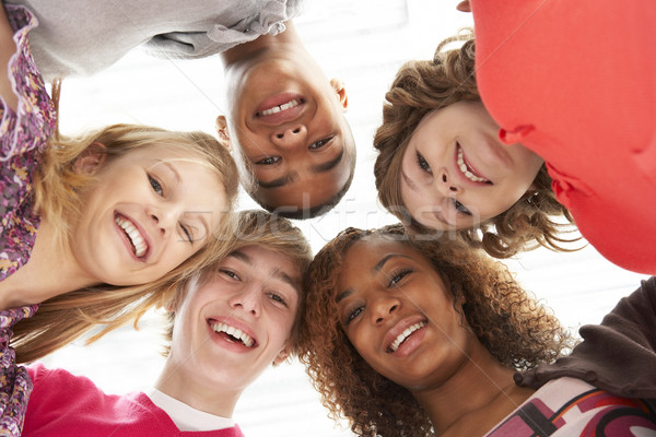 Five Teenage Friends Looking Down Into Camera Stock photo © monkey_business