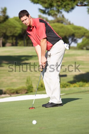 Male Golfer On Golf Course Putting On Green Stock photo © monkey_business