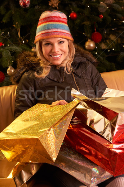 Woman Returning After Christmas Shopping Trip Stock photo © monkey_business