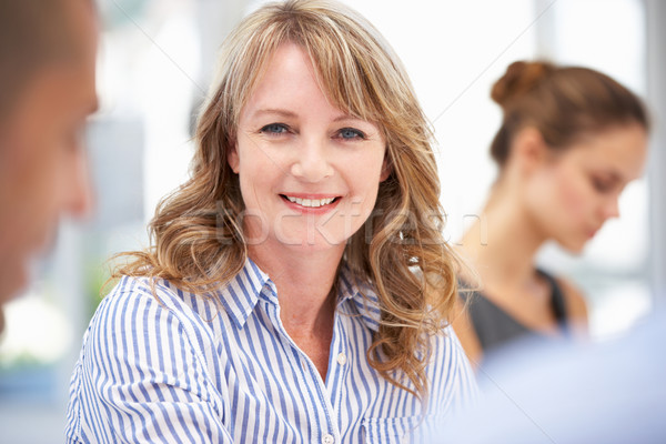 Stock photo: Mid age businesswoman in meeting