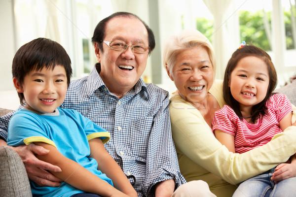 Portrait chinois grands-parents petits enfants détente maison Photo stock © monkey_business