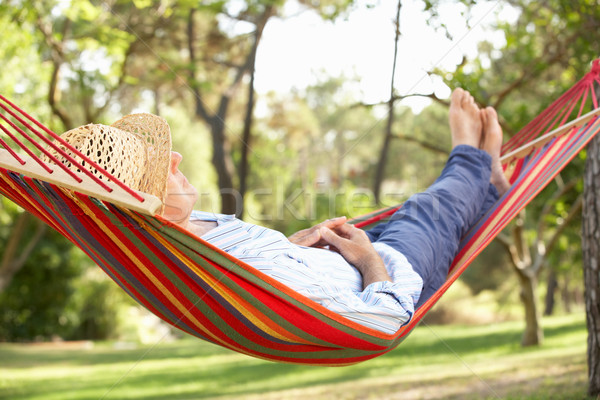 Stock photo: Senior Man Relaxing In Hammock