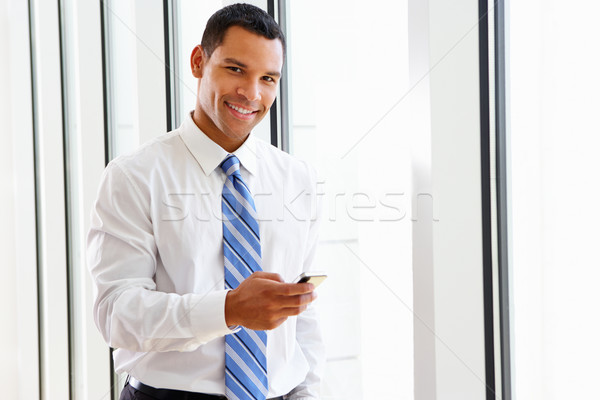 Businessman Using Mobile Phone In Office Stock photo © monkey_business