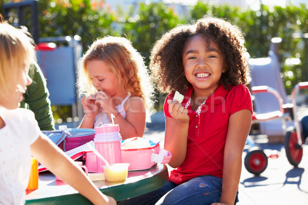 Elementary Pupils Sitting At Table Eating Lunch Stock photo © monkey_business