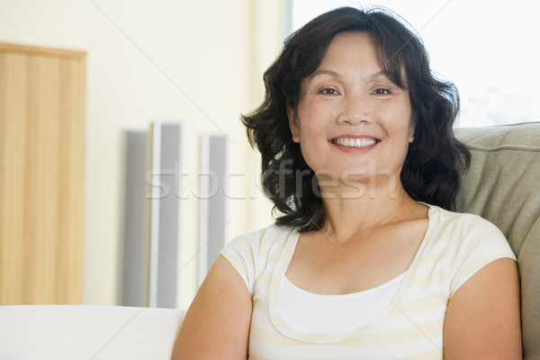 Woman sitting in living room smiling Stock photo © monkey_business