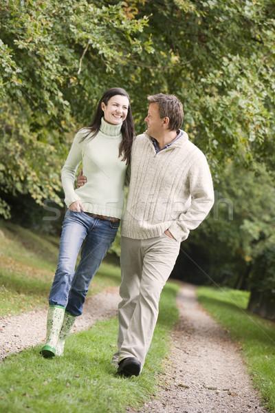 Couple on walk along woodland path Stock photo © monkey_business