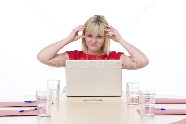 Businesswoman sitting in boardroom with laptop looking frustrate Stock photo © monkey_business