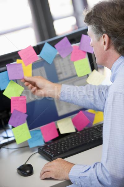 Empresario oficina supervisar notas mujer gente de negocios Foto stock © monkey_business