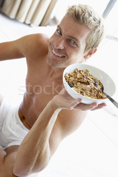 Mid Adult Man Eating A Bowl Of Cereal Stock photo © monkey_business