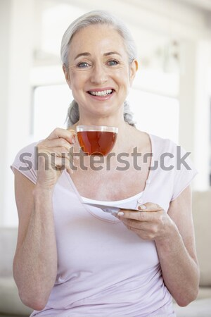 Stock photo: Middle Aged Man Eating Green Apple
