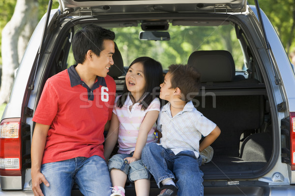 Man with two children sitting in back of van smiling Stock photo © monkey_business