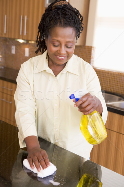 Woman Cleaning Kitchen Counter Stock photo © monkey_business