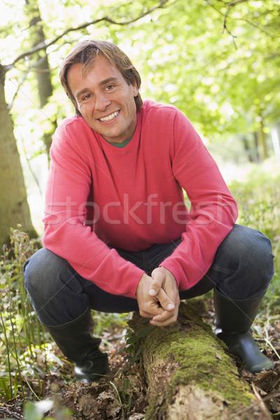 Сток-фото: человека · улице · лесу · сидят · улыбаясь · счастливым