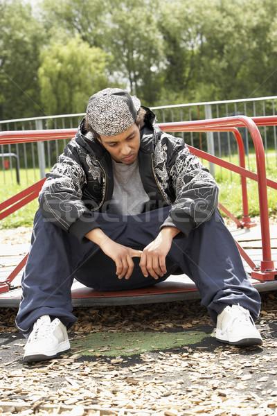 Genç oturma oyun alanı adam üzücü yalnız Stok fotoğraf © monkey_business
