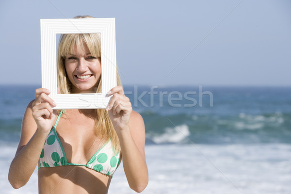 Woman looking through empty frame Stock photo © monkey_business