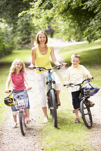 Mother and children riding bikes in countryside Stock photo © monkey_business