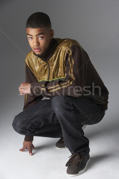 Studio Portrait Of Fashionably Dressed Teenage Boy Stock photo © monkey_business