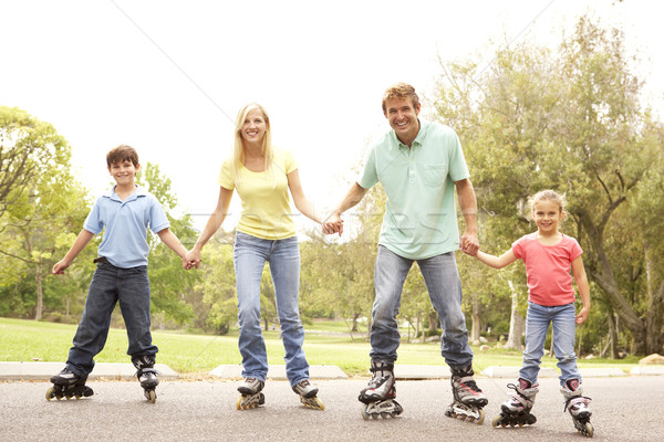 Family Wearing In Line Skates In Park Stock photo © monkey_business