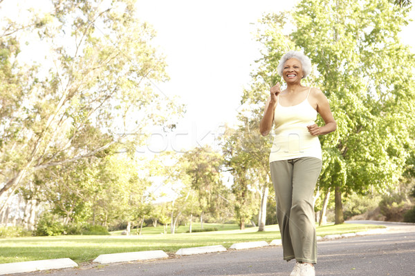 Senior Woman Jogging In Park Stock photo © monkey_business