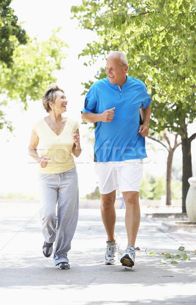 Stock photo: Senior Couple Jogging In Park