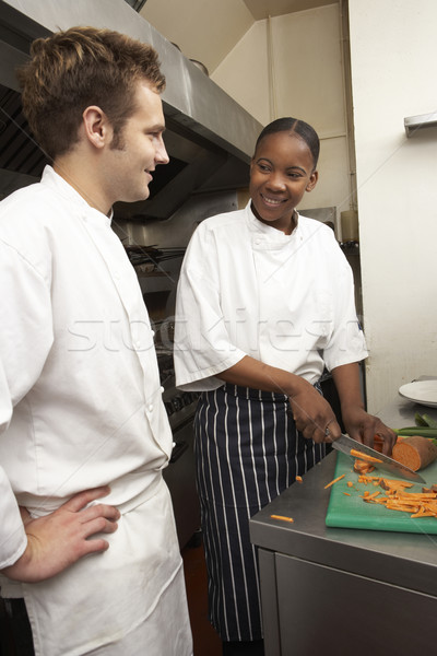 Chef Instructing Trainee In Restaurant Kitchen Stock photo © monkey_business