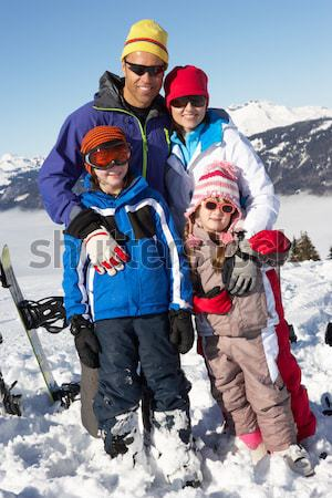 Family Having Snowball Fight In Snowy Landscape Stock photo © monkey_business