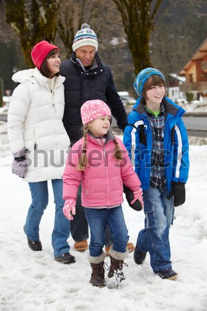Family Enjoying Walk Through Snowy Landscape Stock photo © monkey_business