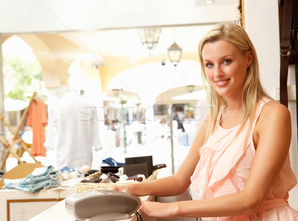 Female Sales Assistant At Checkout Of Clothing Store Stock photo © monkey_business