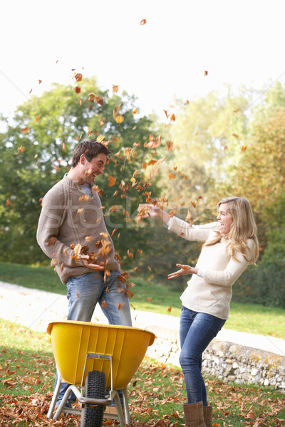 Young couple having fun with autumn leaves in garden Stock photo © monkey_business