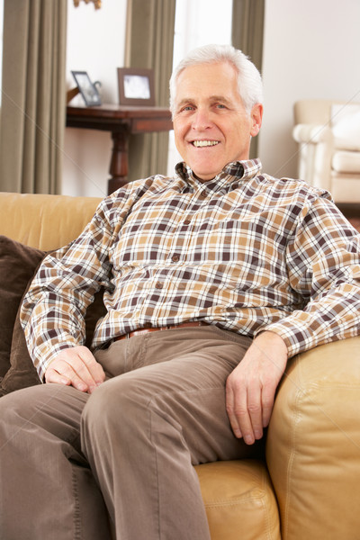 Senior Man Relaxing In Chair At Home Stock photo © monkey_business