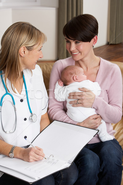 Mother With Newborn Baby Talking With Health Visitor At Home Stock photo © monkey_business