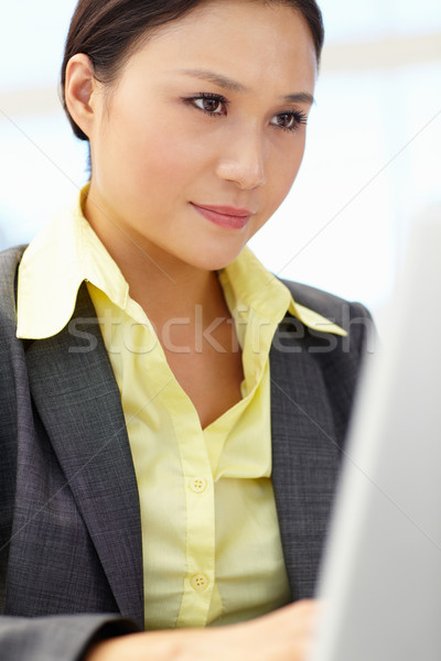 Young businesswoman using laptop Stock photo © monkey_business