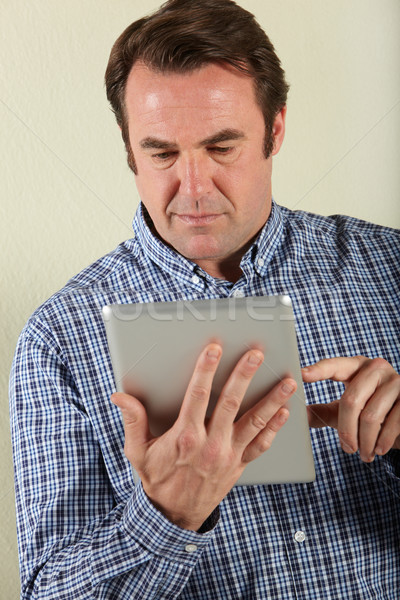 Studio Shot Of Middle Aged Man Using Tablet Computer Stock photo © monkey_business