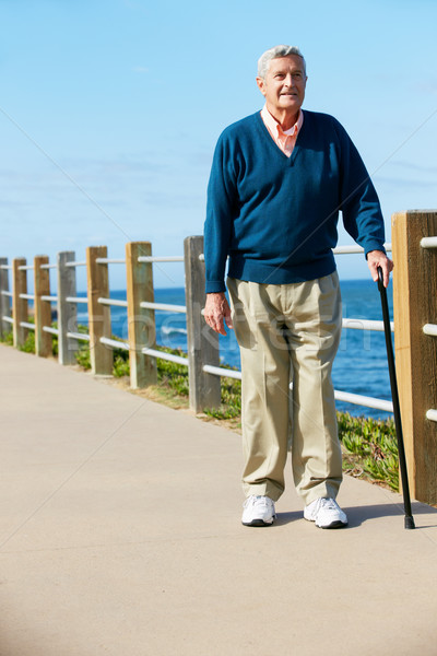 Senior Man Walking Along Path By The Sea Stock photo © monkey_business