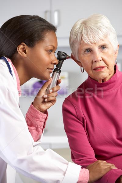 Orvos megvizsgál idős női fülek nők Stock fotó © monkey_business