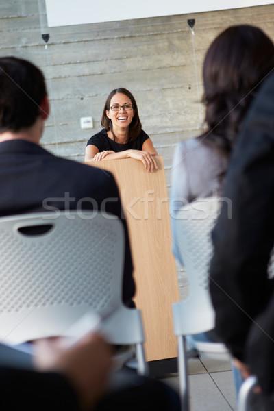 ストックフォト: 女性実業家 · プレゼンテーション · 会議 · ビジネス · 男 · 男性