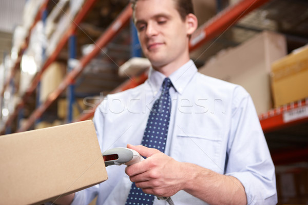 Businessman Scanning Package In Warehouse Stock photo © monkey_business