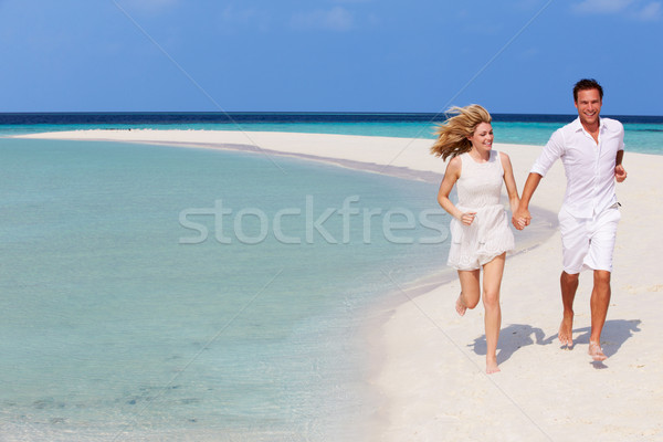 Romântico casal corrida belo praia tropical mulher Foto stock © monkey_business