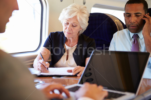 Businesspeople On Train Using Digital Devices Stock photo © monkey_business